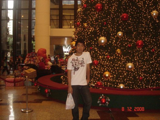 In front of the xmas tree in Berjaya Times Square, KL